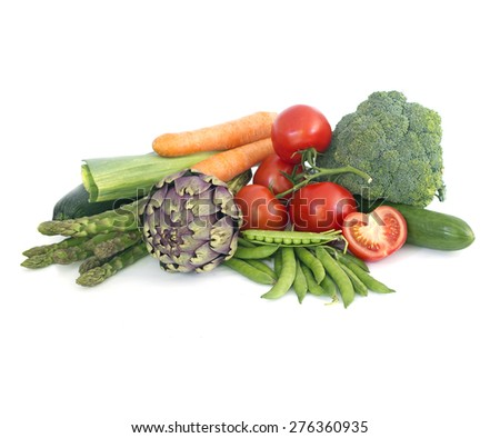 White background with stack of Fresh spring vegetables