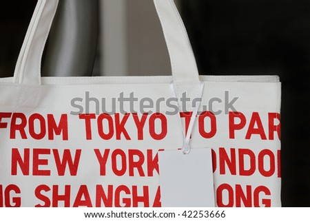 White bag with blank tag - many uses in retail industry. - stock photo