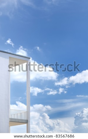 white balcony against blue sky
