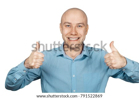 White bald guy in blue shirt on white background showing thumbs up and smiling.