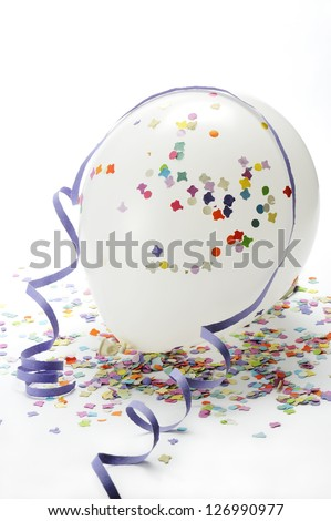 white balloons on colorful confetti and streamers