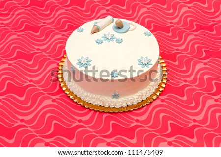 White baptist cake for boy with blue decoration - stock photo