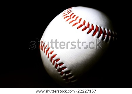 white baseball against dark background - stock photo