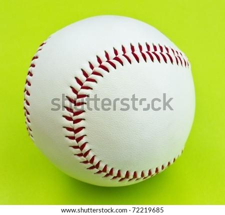 White baseball on bright green background - stock photo