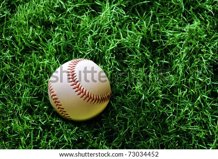 white baseball on green grass sports course