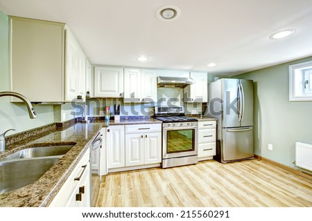 White basement kitchen room. Mother-in-law apartment - stock photo