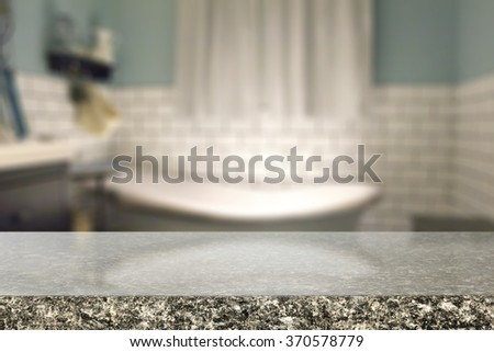 white bath and stone top