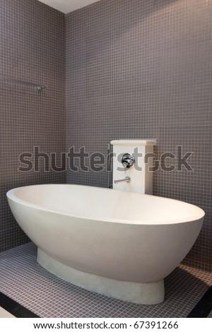white bath in brown bathroom - stock photo