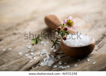 White bath salt on wooden spoon, shallow focus - stock photo