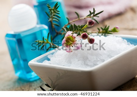 White bath salt with branch of pink flower - stock photo