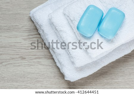 White bath towel with blue soap