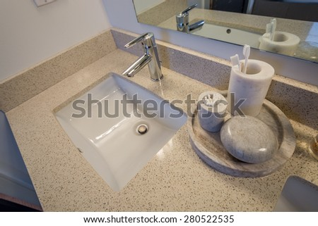 White bathroom sink. Elegant, polished and clean sink stone decorations. Interior design. - stock photo
