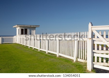 White beach hut on the coast in Bamburgh in Great Britain