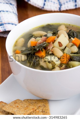 white bean bacon and kale soup bowl closeup