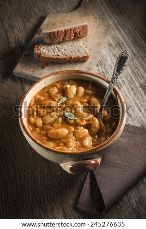 White bean stew with bread close up - stock photo