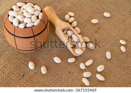 White beans in a barrel on the burlap  - stock photo