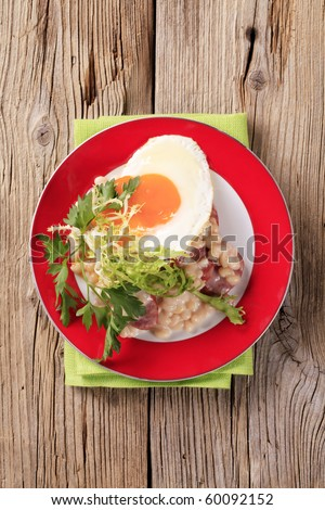 White beans with sausage and fried egg