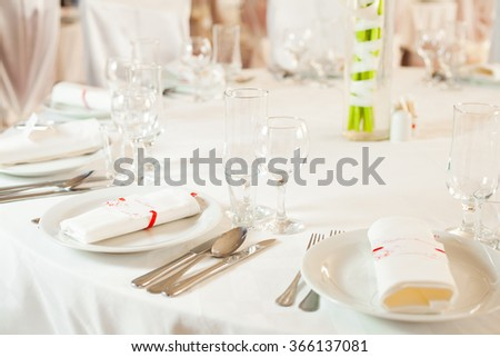White beautiful table set for a wedding dinner - stock photo
