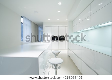 White beauty kitchen interior in luxury home - stock photo