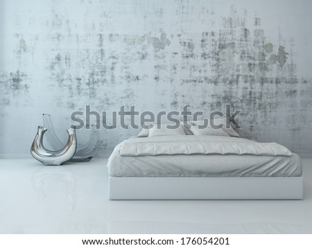 White bed against concrete wall - stock photo