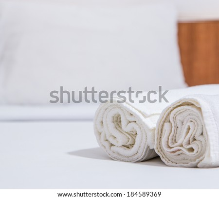 White bed and towels on the bed