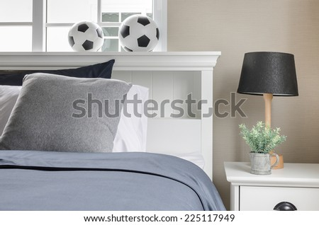 white bed with football on top at home - stock photo