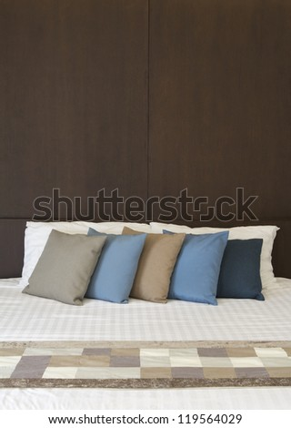 White bed with Multi color pillows - stock photo