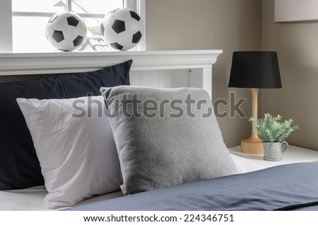 white bed with pillow and  football on top at home - stock photo