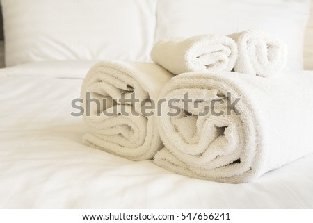 White bedding and towel set in modern hotel