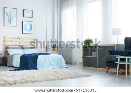 wall posters for bedroom. White bedroom with decorative wall posters  window rug and bed Beautiful Bedroom Dressing Table Bed Stock Photo 637136329