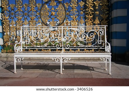 White bench front of royal palace fence