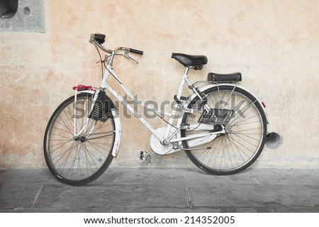 White bicycle against the wall