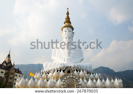 White Big Buddha images with different sizes. at Wat Phasornkaew or Wat Phra Thart Pha Kaew is a buddhist monastery and temple in Khao Kor, Phetchabun. - stock photo