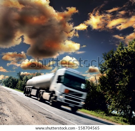 white big truck on the asphalt road - stock photo
