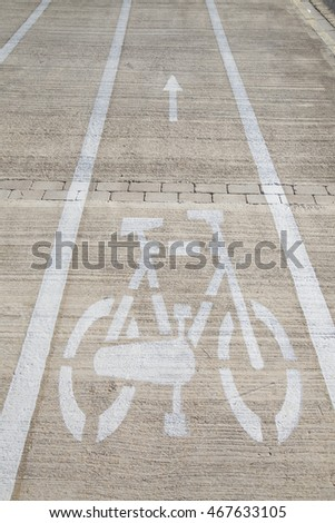 White Bike Lane Sign Painted on Pavement