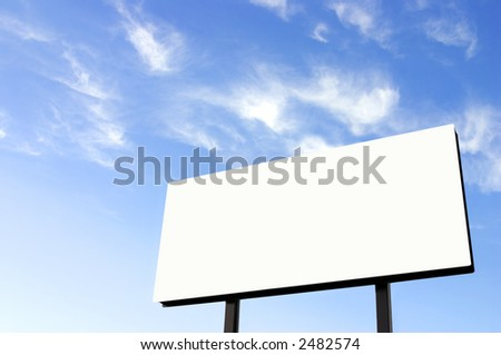 White billboard and a wispy blue sky - Note improved version of the earlier image - stock photo