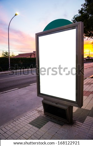 white billboard in a street at sunset - stock photo