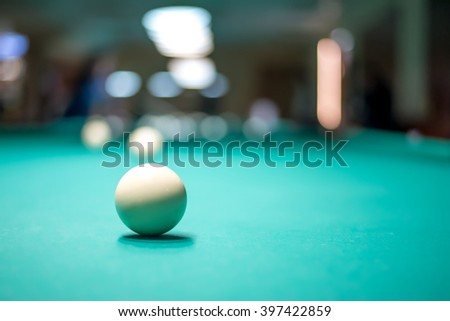 white billiard ball in a green table - stock photo
