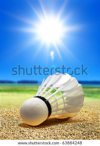white birdie for badminton on course in front of driver - stock photo