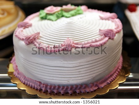 White birthday cake. - stock photo