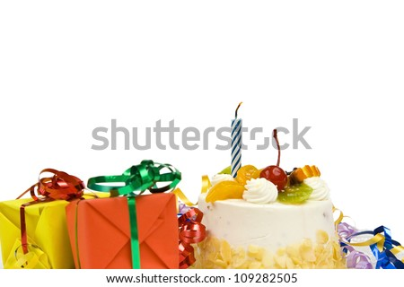 White birthday cake with fruit and blue candle