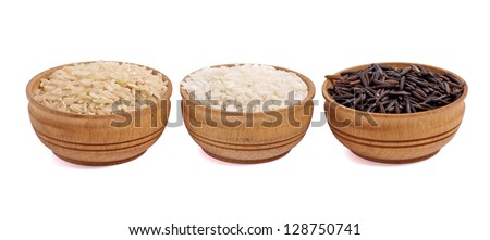 White, black and brown rice isolated on white background - stock photo