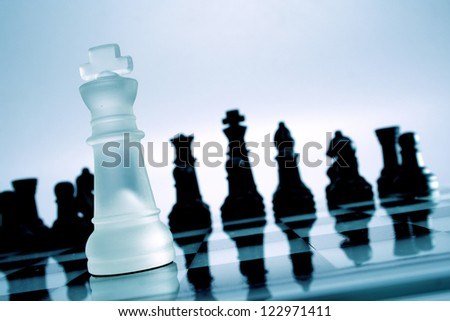 White & Black chess pieces on chess board - stock photo