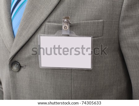 White Blank Badge  on mens torso - stock photo