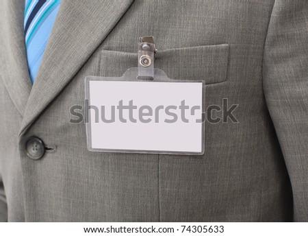 White Blank Badge  on mens torso - stock photo