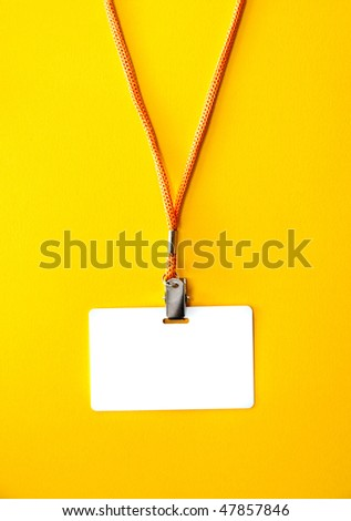 White Blank Badge with an orange strap on a bright yellow background - stock photo