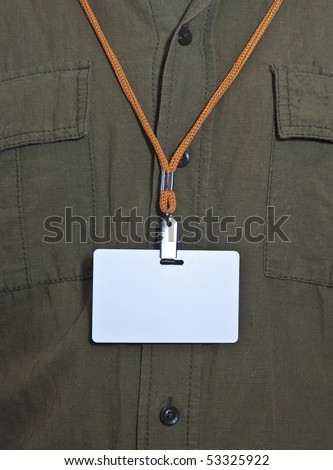 White Blank Badge with an orange strap on mens torso - stock photo