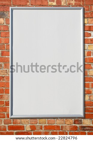 White blank billboard sign on a red brick wall. - stock photo