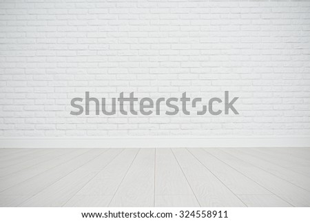 white blank brick wall and wooden floor in an empty room - stock photo