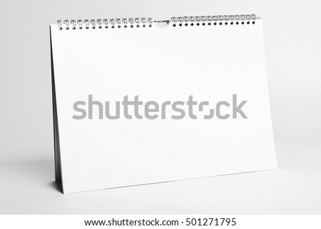 white blank calendar mockup with spiral binding